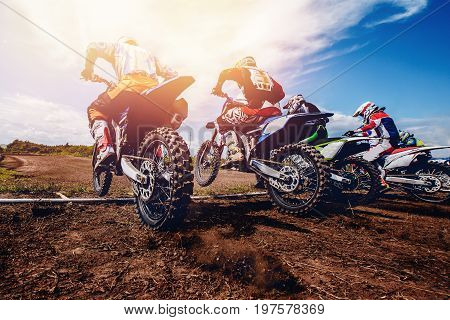 team of athletes on mountain bikes starts, cross-country. Concept active rest motocross.