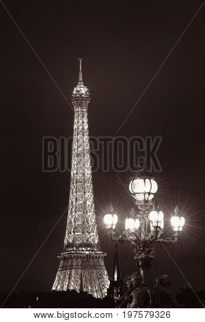 PARIS, FRANCE - MAY 13: Eiffel Tower and vintage lamp on May 13, 2015 in Paris. With the population of 2M, Paris is the capital and most-populous city of France