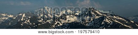 Snow mountain tops. Mount Zakzan-Syrt and mount Pshish. Greater Caucasus Mountain Range. Karachay-Cherkessia. Russia.