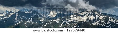 Mountain peaks covered by snow. Greater Caucasus Mountain Range. Karachay-Cherkessia. Russia.