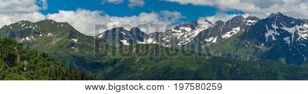 Tops of mountains range with snow caps. Greater Caucasus Mountain Range. Karachay-Cherkessia. Russia.