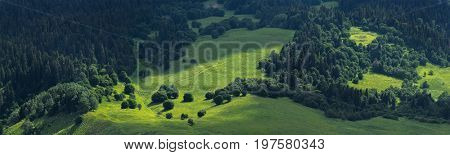 Top view on green valley of Pkhiya district. Caucasus mountains. Karachay-Cherkessia. Russia.
