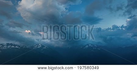 Greater Caucasus Mountain Range at dusk. Sky landscape in blue tone. Karachay-Cherkessia. Russia.