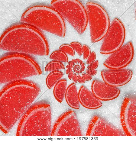 Abstract fruit jelly wedges red cantle lobule on white sugar background. Red jellies. Abstract fruit jelly on white sugar background. Red Orange jellies. Sweet fruit segments