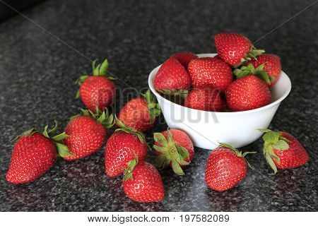 Small White Bowl Filled With Appetizing Strawberries.