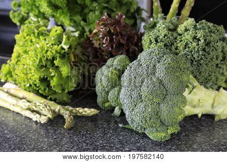 Fresh Green Broccoli With Lettuce On A Table