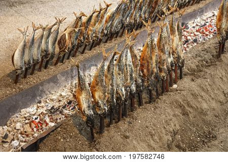 Fireplace of the Fischer Vroni tent on the Theresienwiese during Oktoberfest with it's famous fish on a stick