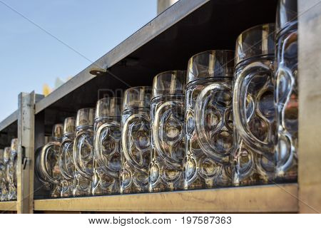 Munich Germany - September 24 2016: Behind the scenes of the Oktoberfest in the beer garden of the Ochsenbraterei with beer steins being cleaned and prepared