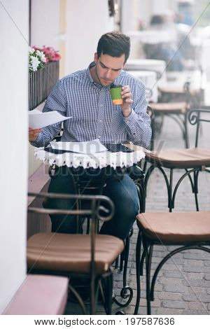 Businessman workaholic working at lunchtime. Busy man in cafe, young male with coffee
