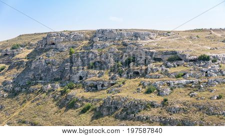 Caves on the side of the Gravina Canyon face Matera. Once used as shelter for shepherds. Basilicata Italy