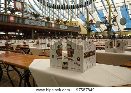 Munich, Germany - September 24, 2016: Inside the Ochsenbraterei beer tent at Oktoberfest with empty tables in the reservation area