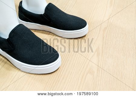 White Skin Mannequin Model Feet Wearing Black Canvas Casual Shoe