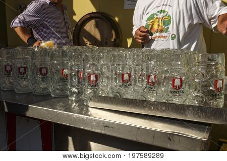 Munich, Germany - September 24, 2016: Behind the scenes of the Oktoberfest in the beer garden of the Ochsenbraterei with beer steins being cleaned and prepared