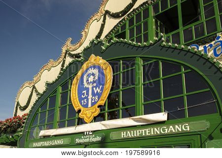 Munich, Germany - September 24, 2016: Main street at Oktoberfest with the entrance to the Augustiner tent on Theresienwiese