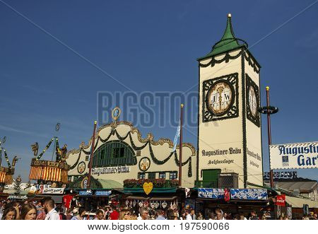 Munich, Germany - September 24, 2016: Main street at Oktoberfest with the Augustiner tent on Theresienwiese and its famous tower