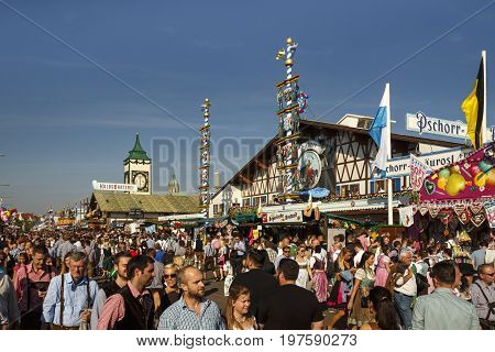 Munich, Germany - September 24, 2016: Main street with people walking along and the Braeurosl beer tent in the background