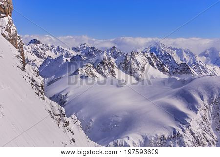 Wintertime view from Mt. Titlis in Switzerland. The Titlis is a mountain located on the border between the Swiss cantons of Obwalden and Bern, it is mainly accessed from the town of Engelberg on its north side.