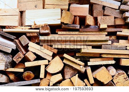 Background of timbers and logs stacked in woodshed.