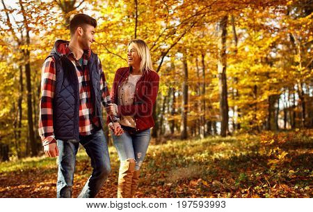young couple enjoying in the autumn park