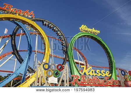 Munich, Germany - September 24, 2016: The Olympia Looping rollercoaster at Oktoberfest is a famous fun ride and attracts many people