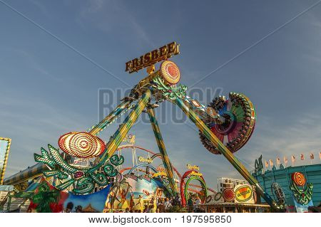 Munich, Germany - September 24, 2016: Fun ride in motion with people flying through the air on Theresienwiese