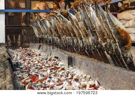 Munich, Germany - September 24, 2016: Fireplace of the Fischer Vroni tent on the Theresienwiese during Oktoberfest with it's famous fish on a stick