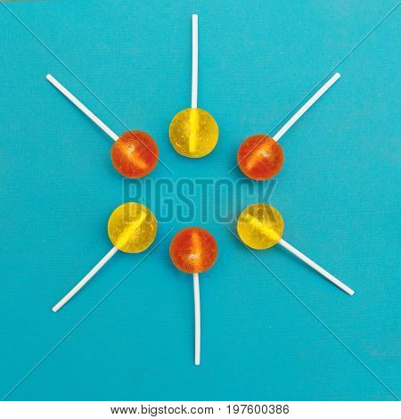 Lollipop Flat lay Minimal concept Six multicolored round lollipops are lying on a light blue background Trendy bright photo in modern pop art style Top view