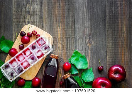 Summer fruit drink on wooden table top view.