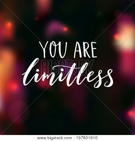 You are limitless. Encouraging quote. Motivational saying, brush lettering on dark background with pink bokeh