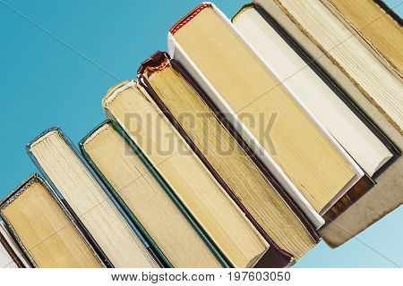 books on blue background. Education concept school