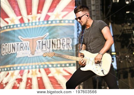 TWIN LAKES, WI - JUL 20: Chase Bryant performs during 2017 Country Thunder Music Festival on July 20 2017 in Twin Lakes, Wisconsin.