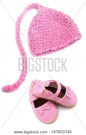 Pink knitted newborn baby girl elf hat and matching polka dot shoes.
