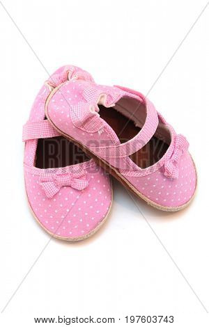 Newborn baby girl shoes in pink polka dots.