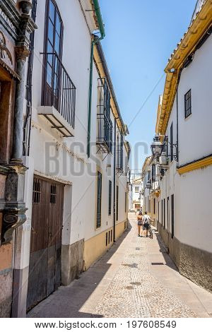 Cordoba, Spain - June 20 : A Lone Couple Walking On The Streets Of Cordoba On June 20, 2017.