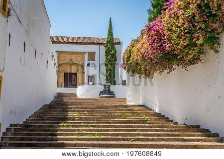 Stone Steps Leading To A Church In The City Of Codoba, Spain, Europe On A Bright Summer Day With A B