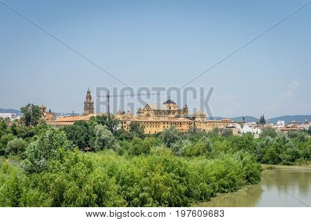 The Cathedral Mosque And Bell Tower Of Cordoba From The Bridge On The River Guadalquivir