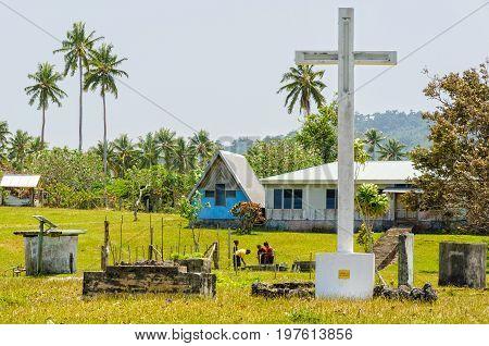 Gigantic white concrete cross at the northern end of Port Olry - Espiritu Santo, Vanuatu, 26 September 2012