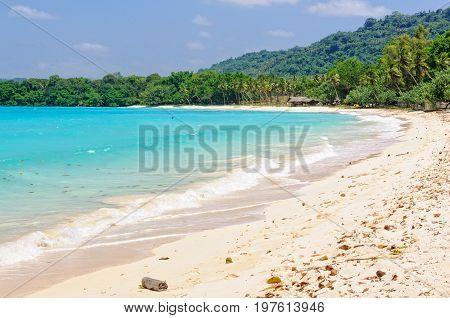 Sandy beach and turquoise water in the bay at Port Olry - Espiritu Santo, Vanuatu