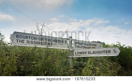 Traditional English Country signs for Lower Slaughter, Upper Slaughter, Bourton-on-the water and Cheltenham in the Cotswolds.