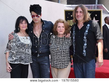 LOS ANGELES - JUL 20:  Criss Angel, Dimitra Sarantakos, aunt Stella and cousin George arrives for the Criss Angel Hollywood Walk of Fame Star Ceremony on July 20, 2017 in Hollywood, CA