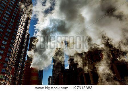 Steam pipe releasing hot air into the street in Midtown Manhattan. air steam accident repair