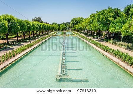 Water Fountain In The Gardens Of The Alcazar De Los Reyes Cristianos Castle At Cordoba, Spain, Europ