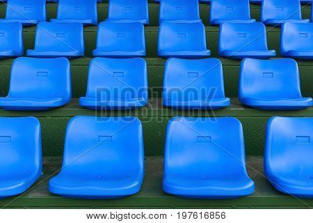 lines of blue stadium seats horizontal composition