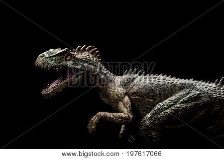 an allosaurus on a dark background horizontal