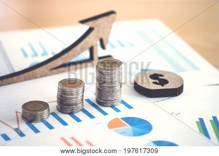 financial banking stock spreadsheet with stack of coin and background on accountant data growth rate finance saving investment business and banking concept.