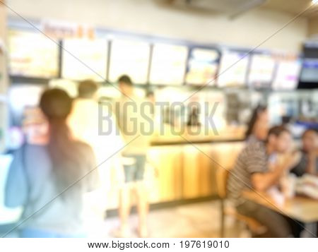 Blurred Image Of People Wait To Order Food And Make Payment In Fastfood Store.
