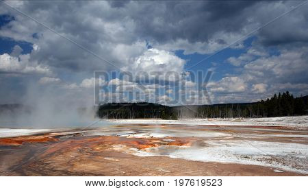 Black Sand Geyser Basin below cumulus cloudscape in Yellowstone National Park in Wyoming United States of America