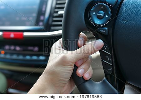 People Using Wireless Speaker Control Mobile Phone In Car