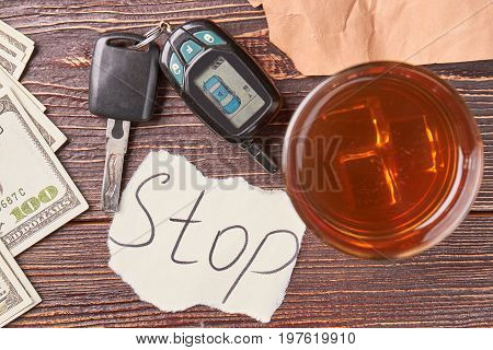 Alcohol, car key, top view. Stop drink alcohol and drive automobile concept.