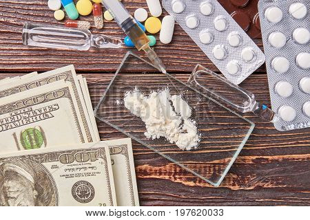 Illegal drug trafficking, narcotic preparations. Money of junkie for heroin sale.